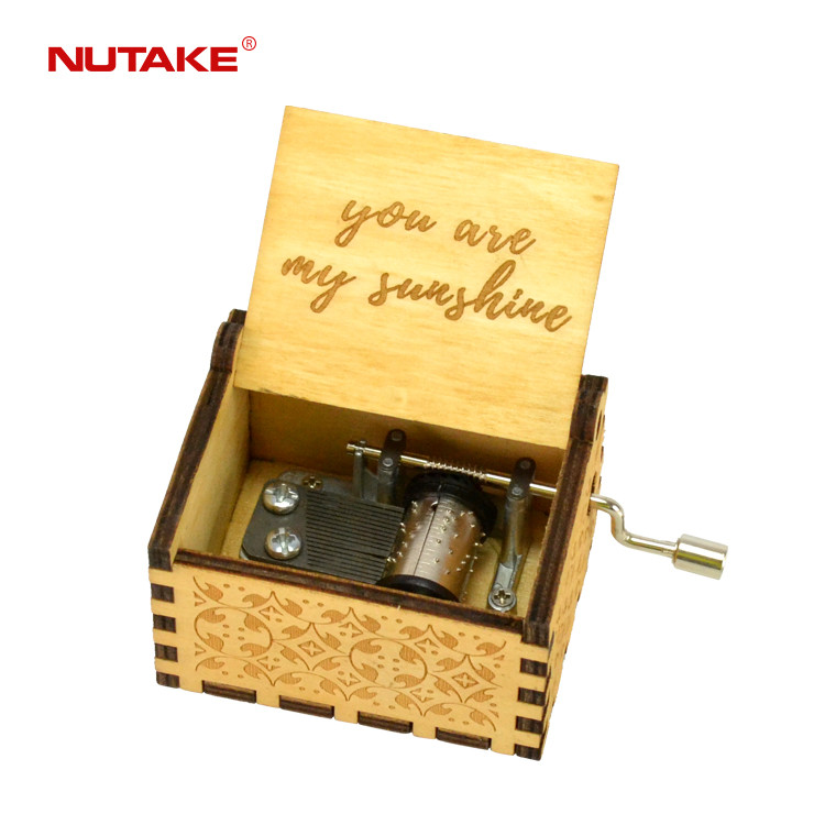 Hand cranked wooden music box that plays you are my sunshine 55805101-32,1