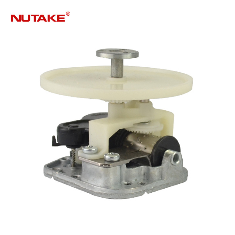 18 note rotating music box movement with rotating shaft and plate in tow direction 10188001-12