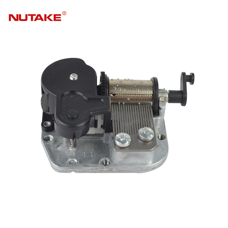 18 note music box mechanism with rotating drum shaft crank 10188001-14
