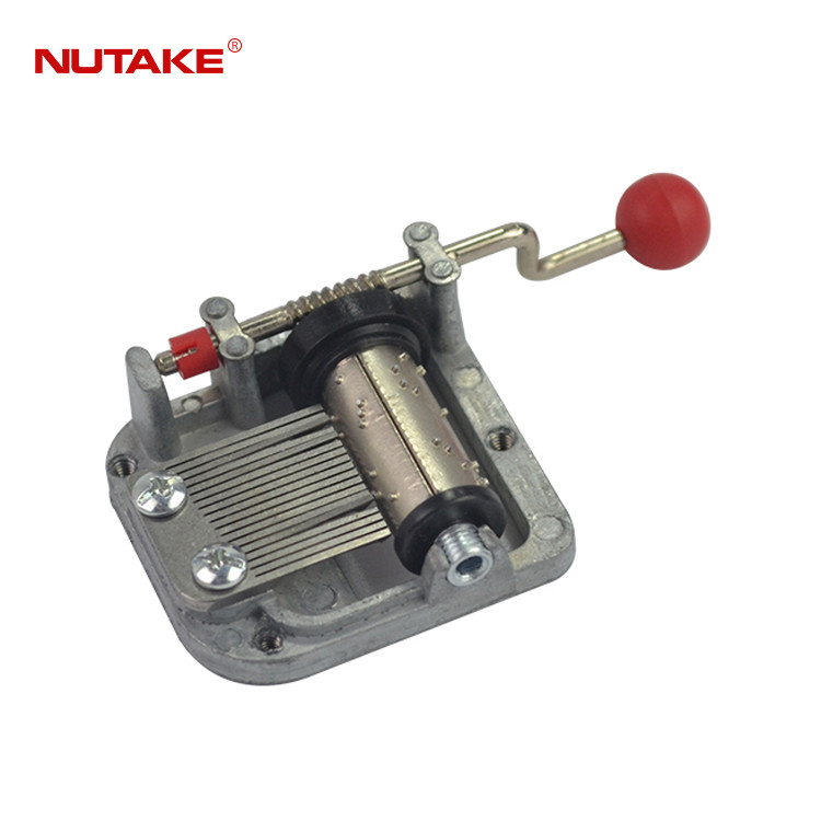18 note hand crank miniature music movement with plastic ball handle 10188016